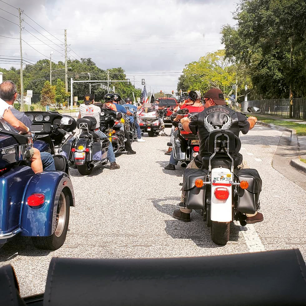 Group of riders stopped in the road